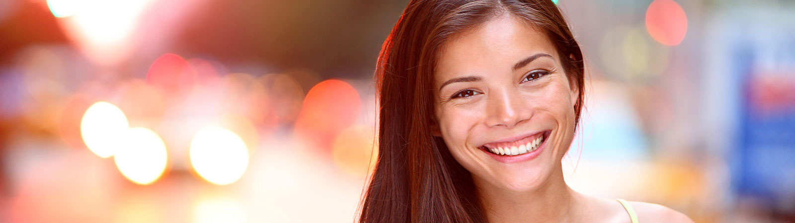 woman with a beautiful smile looking at the camera
