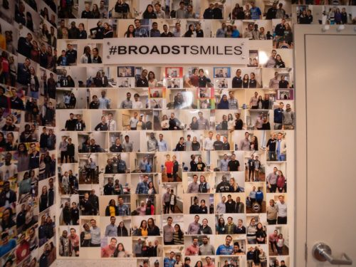 wall with dozens of photos of happy BSB patients