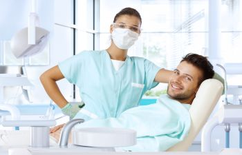 Patient in Dentist Chair with Orthodontist